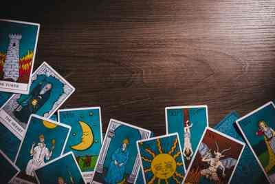 assortment-tarot-inspired-cards-on-450w-1069391891.jpg